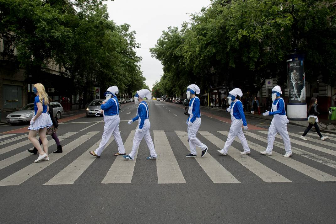 Smurfs stag do walking on Andrassy street Beatles style